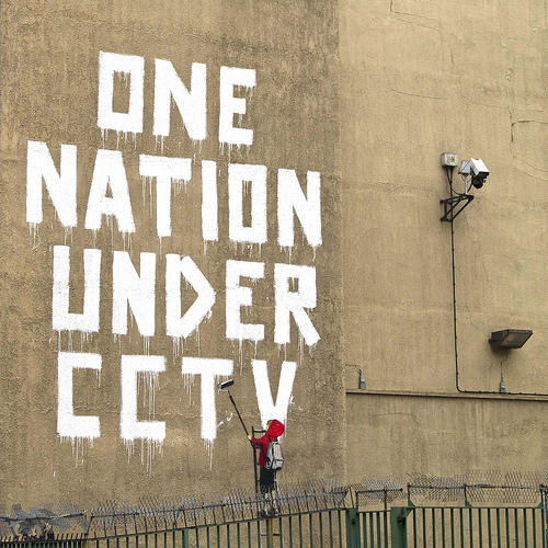 graffiti artist Banksy painted this while being watched by a CCTV camera