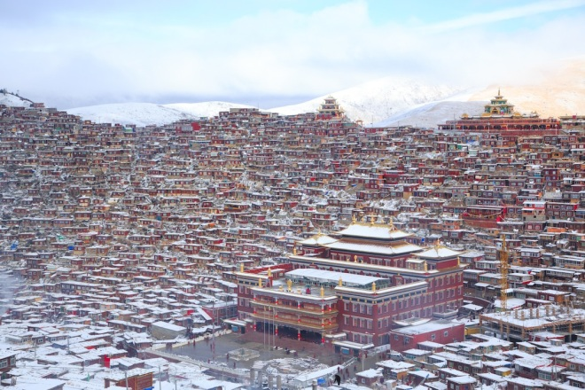 Larung Gar Gompa, East Tibet. A dense collection of monk quarters sprawled out over a hill.*