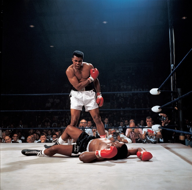Muhammad Ali in action after first round knockout of Sonny Liston at St. Dominic's Arena, Lewiston, ME May 25, 1965.