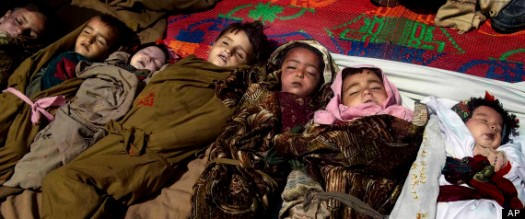 The lifeless bodies of Afghan children lay on the ground before their funeral ceremony, after a NATO airstrike killed several Afghan civilians, including ten children during a fierce gun battle with Taliban militants in Shultan, Shigal district, Kunar, eastern Afghanistan, Sunday, April 7, 2013. The U.S.-led coalition confirms that airstrikes were called in by international forces during the Afghan-led operation in a remote area of Kunar province near the Pakistan border. (AP Photo/Naimatullah Karyab)